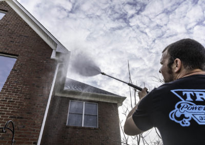 worker-spraying-house-with-water